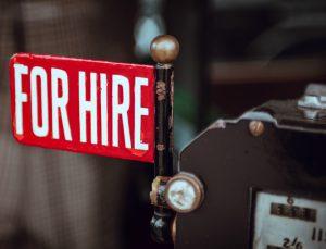battered for hire sign