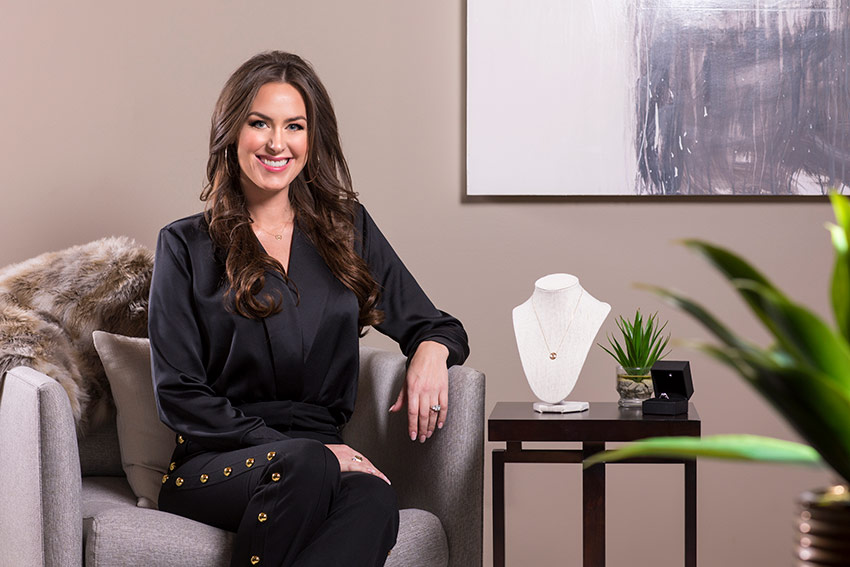 Mount Royal Graduate and entrepreneur, Lindsay Jones sits on a couch.