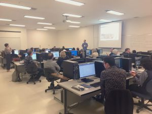 Group of individuals in computer lab for H5P workshop.