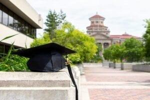a graduation cap placed on a concrete step