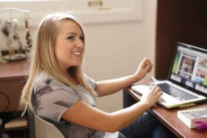 smiling woman at a laptop