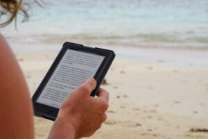 a person viewing text on an e-reader
